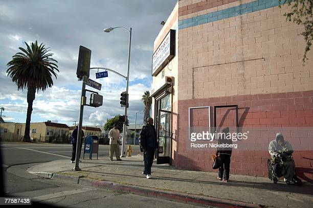 Local residents stand around the corner of Crenshaw Boulevard and 63rd Street September 22 in south central Los Angeles California The area is well...