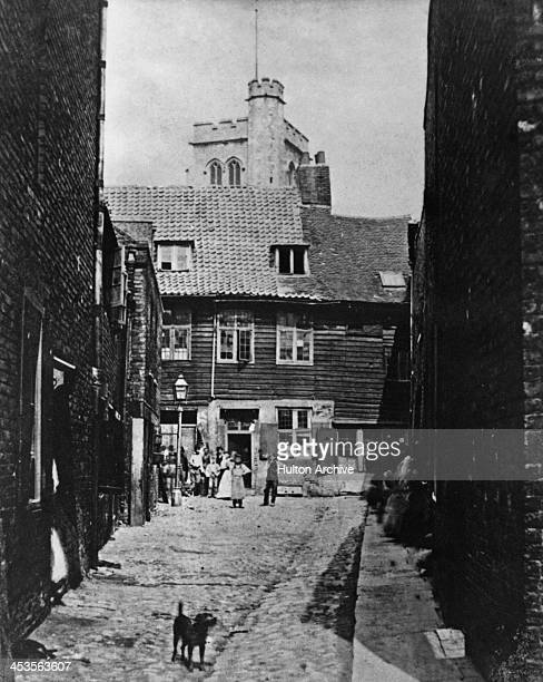 Local residents stand in the street in Palace Yard Lambeth London circa 1870