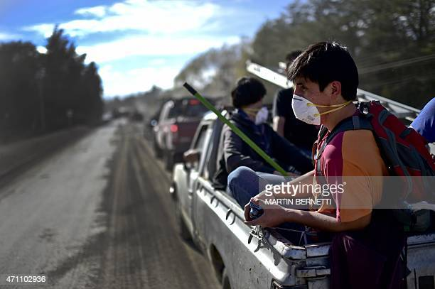 Local residents stay on vehicles at a street covered with ashes from the Calbuco volcano at La Ensenada, southern Chile, on April 25, 2015....