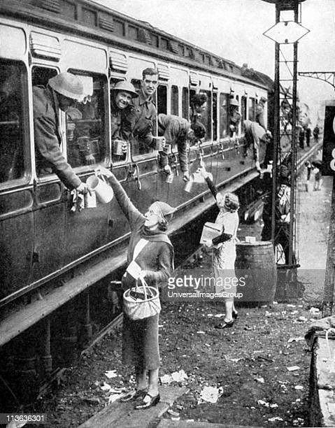 Local residents supplying refreshments to trainload of British soldiers who had been withdrawn from the beaches of Dunkirk on 34 June 1940 and...