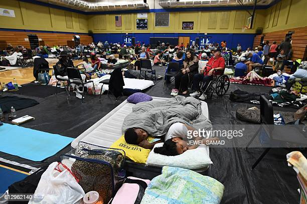 Local residents take shelter at the Pedro Menendez high school in St Augustine Florida on October 6 ahead of hurricane Matthew Some 15 million people...