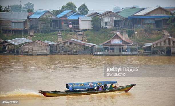 Local residents travel by boat along the Kahayan river in Palangkaraya in Central Kalimantan on October 29 2015 as residents enjoy clearer skies...