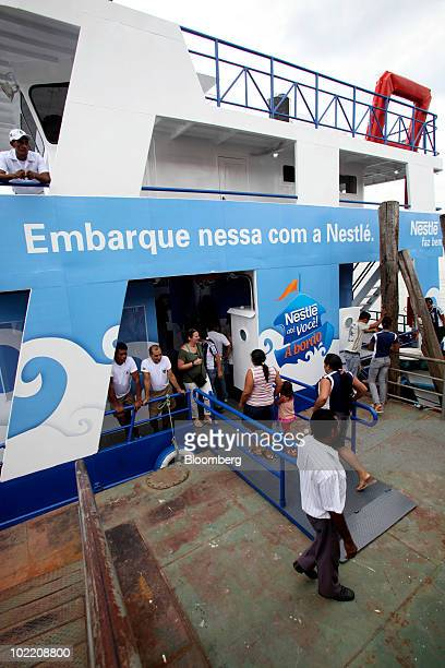 Local residents visit the Nestle SA supermarket boat in Barcarena Brazil on Friday June 18 2010 Nestle SA today began sailing the supermarket barge...