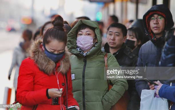 Local residents wait for a bus in Baotou city, Inner Mongolia, on Saturday morning Nov. 18, 2017. The metro construction in Baotou city has been...