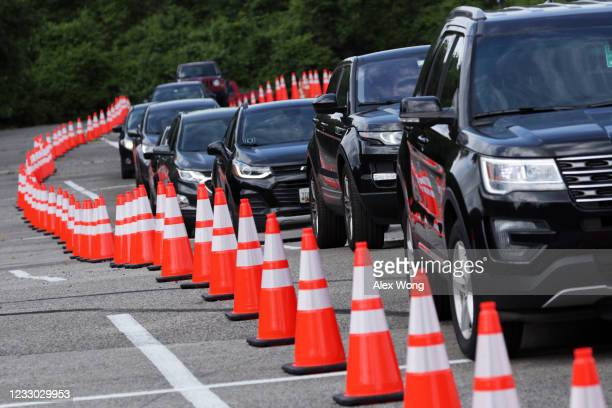 Local residents wait in their vehicles as they line up for a coronavirus test at a drive-thru testing location at Six Flags America May 29, 2020 in...