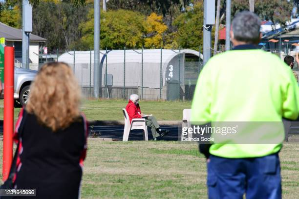 Local Residents wait to be tested at a new testing location in West Dubbo on August 13, 2021 in Dubbo, Australia. Dubbo Regional Council entered a...