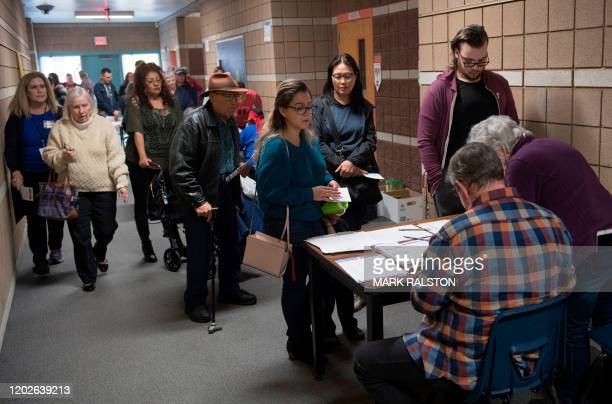 Local residents wait to cast their votes during the Nevada caucuses to nominate a Democratic presidential candidate at the caucus polling station...