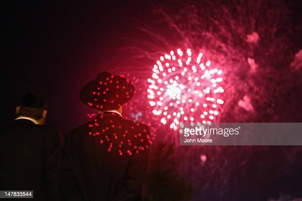 Local residents watch a fireworks display at the horse racing track on July 4, 2012 in Monticello, New York. Communities around the country...