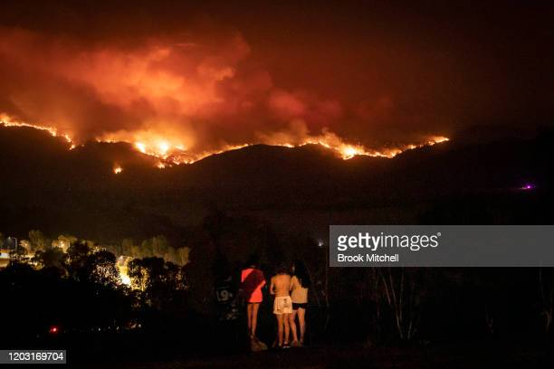Local residents watch as fire burns to the suburban fringe of the city of Canberra on January 31, 2020 in Canberra, Australia. ACT Chief Minister...