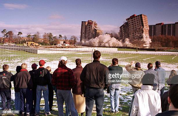 Local residents watching the demolition of a block of flats at Ardler in Dundee. The flats were being demolished to make way for new low-rise housing...