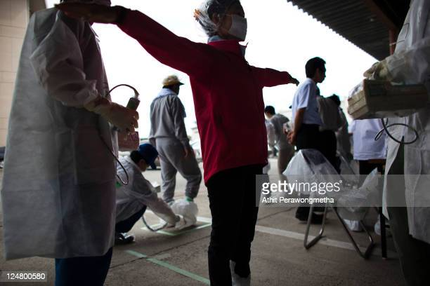 Local residents who live around the 20km exclusion zone around the Fukushima Dai-Ichi Nuclear Power Plant, undergo a screening test for possible...