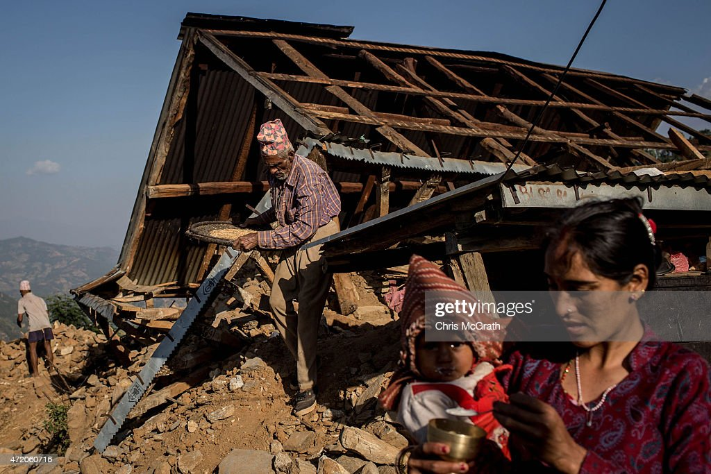 Local residents work to rebuild their home in Bhotechaur, Nepal on May 3, 2015 in Kathmandu, Nepal. A major 7.9 earthquake hit Kathmandu mid-day on Saturday, and was followed by multiple aftershocks that triggered avalanches on Mt. Everest that buried mountain climbers in their base camps. Many houses, buildings and temples in the capital were destroyed during the earthquake, leaving over 6000 dead and many more trapped under the debris as emergency rescue workers attempt to clear debris and find survivors. Regular aftershocks have hampered recovery missions as locals, officials and aid workers attempt to recover bodies from the rubble.