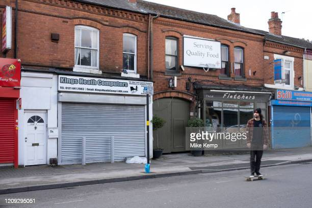 Local response to Coronavirus is felt on a street by street level as shops and small businesses are closed up with their shutters pulled down on 6th...