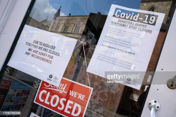 Local response to Coronavirus is felt on a street by street level as signs in small shops and businesses announce that they are closed for business...