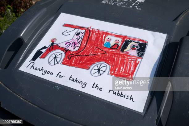Local response to Coronavirus is felt on a street by street level as children put up drawings in at home to say thank you to refuse collectors on...