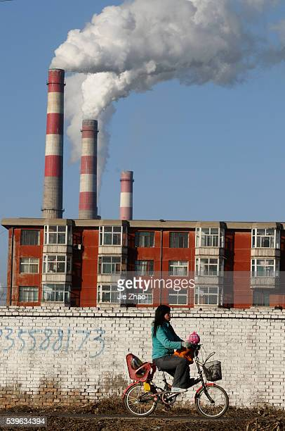 A local rides near a heat power plant in Changzhi Shanxi province December 21 2009 UN climate talks ended with a bareminimum agreement on Saturday...
