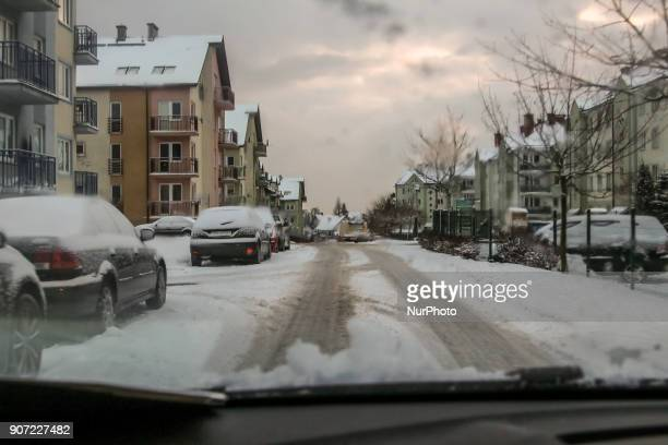 Local road covered by snow is seen in Gdansk Poland on 19 January 2018 Heavy snow fall and wind Power has been cut to some 30000 Polish homes after...