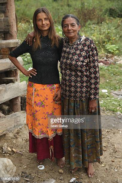 Local Roma resident Marinela Boldis poses for a photo with her mother Livia Moldovan in the abjectly poor Roma settlement of Ponorata on September 10...