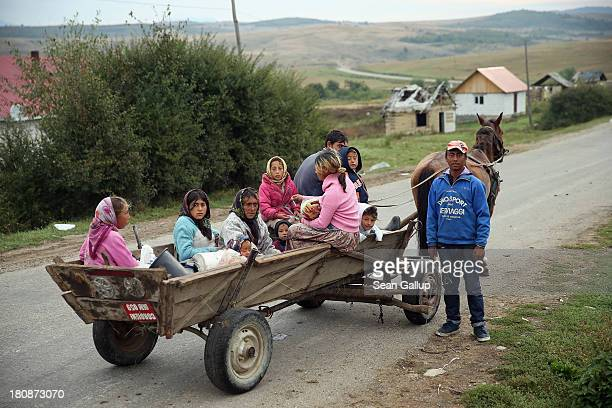 Local Roma residents pause while riding their horsedrawn cart which for many locals is the main means of transportation out of town in the abjectly...