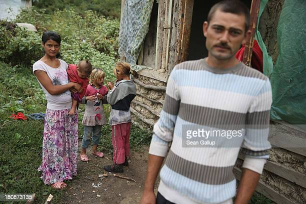 Local Roma residents Romeo Moldovan his wife Smocina Boldis and their infant daughter Daria stand outside their oneroom wood straw and mud hut in the...