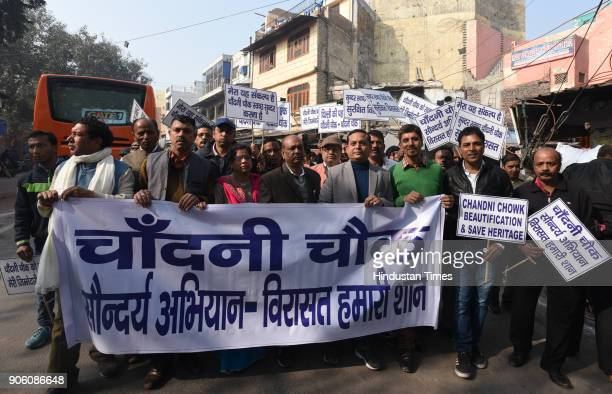 Local RWA members participating with Vijay Goel in a march to appeal masses on Swachhta at Chandhi Chowk on January 17 2018 in New Delhi India