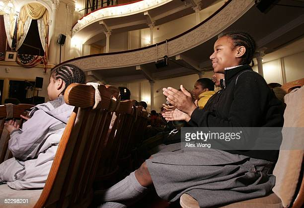 Local school children applaud as they watch a performance during a living black history program at the Ford's Theatre March 7 2005 in Washington DC...