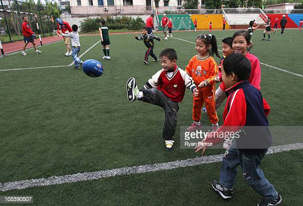 Local school children from PingLiang No 4 School participate in an Auskick clinic with Melbourne FC players on October 14 2010 in Shanghai China The...
