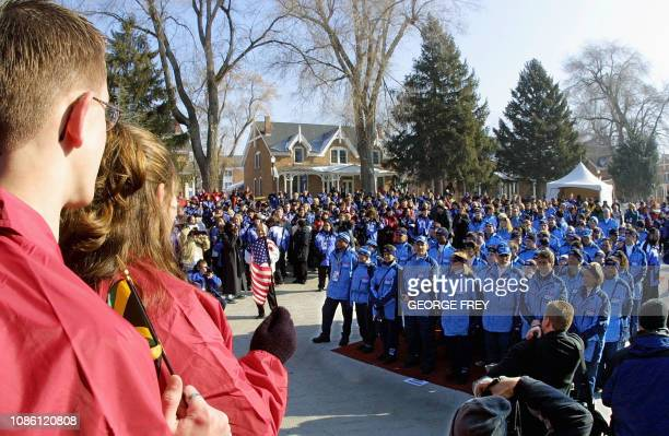Local school children greet US athletes at a welcoming ceremony at the Olympic Village 05 February 2002 in Salt Lake City Utah before the start of...