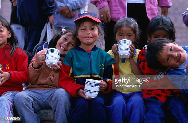 Local school children having their lunch on the Plaza de Armas in Cusco.