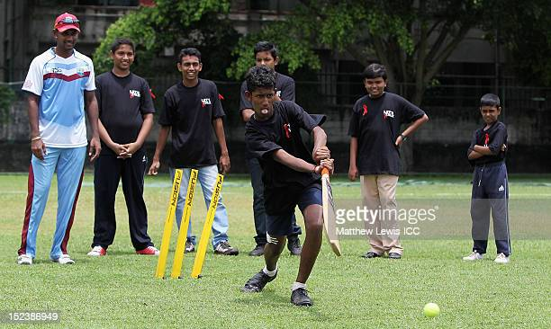 Local school children participate in a training session with Denesh Ramdin of the West Indies Cricket team at Colts Cricket Club on September 20 2012...