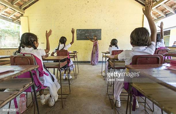 local school classroom in sri lanka - sri lankan school girls stock photos and pictures