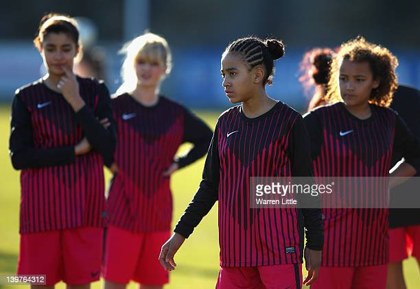 Local school girls are coached by a few Chelsea Ladies firstteam players at Staines Town FC to celebrate a new partnership between the two clubs on...