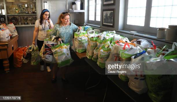 Local school teachers collect food bags for their school at the food bank set up by public house owner Teresa McCarthyDixon at the Swan and Helmet...