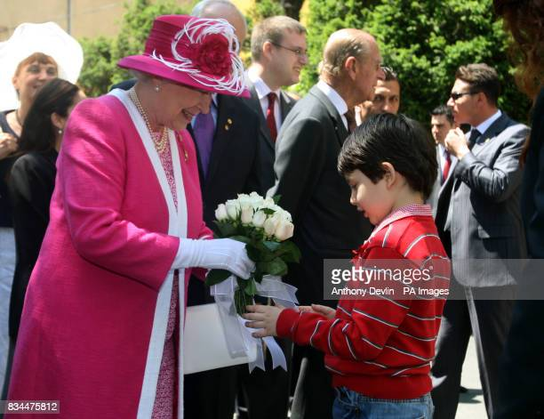A local schoolboy presents flowers to the Queen during her visit to Kabatas school in Istanbul on the third day of Their Royal Highnesses visit to...