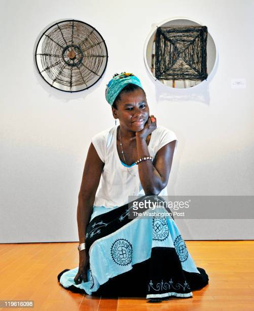 Local sculptor Adjua Williams with one of her untitled pieces in two parts at the David C Driskell Center at the Univesity of Maryland on July 2011...