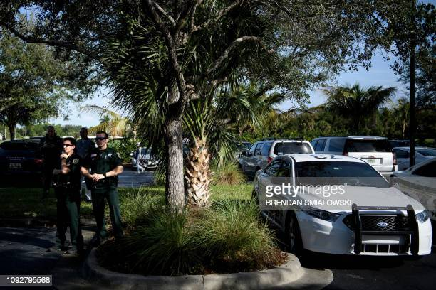 Local sheriffs wait as US President Donald Trump visits the Trump National Golf Club on February 2 in Jupiter Florida