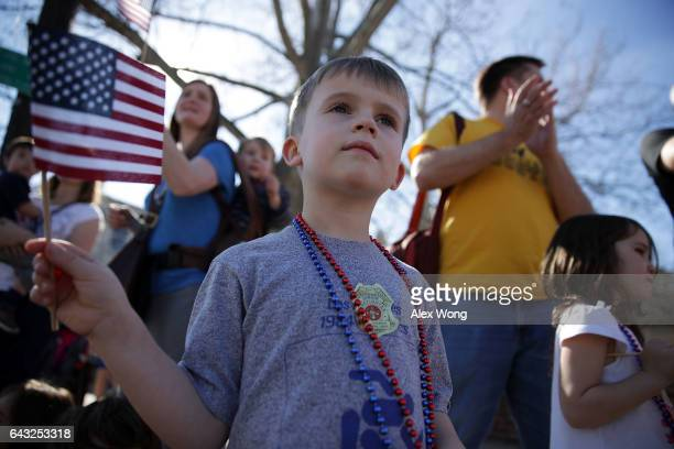 Local sixyearold resident Alistair Danewitz watches the annual George Washington Birthday Parade with his family February 20 2017 in Old Town...