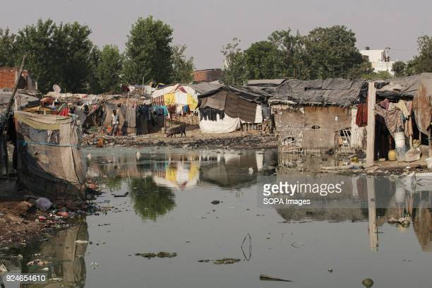 A local slum seen next to extreme dirty water Over 25 million people live in Delhi India What is particularly problematic in India is environmental...