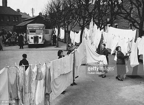 Local soap manufacturer Hudson's helps housewives without power or water due to bombings by offering free mobile laundry service.