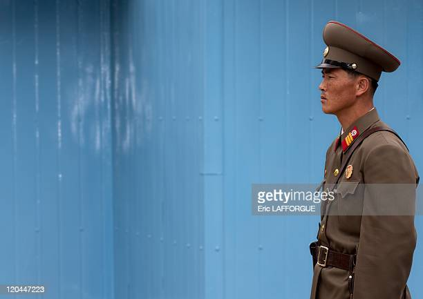 Local soldiers at DMZ in North Korea on April 21 2008 The Korean Demilitarized Zone KMZ is a strip of land running across the Korean Peninsula that...