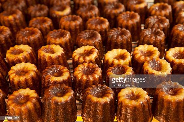 Local speciality cakes caneles on sale in patisserie in St Emilion Bordeaux France