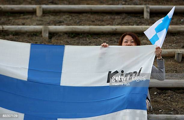 Local spectator comes to support Kimi Raikkonen of Finland and Ferrari during practice for the Japanese Formula One Grand Prix at the Fuji Speedway...