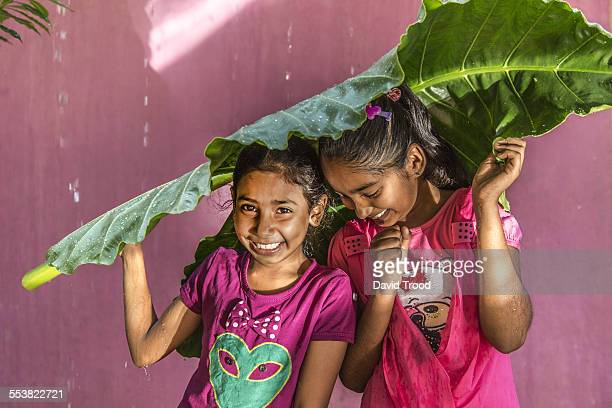Local Sri Lankan girls shelter from the rain.