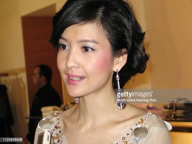 Local star Vivian Chow Waiman cutting ribbon for Louis Vuitton 25 January 2006