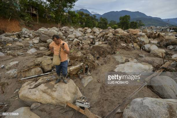 A local stares at the rubble left by mudslides following heavy rains in Mocoa Putumayo department southern Colombia on April 2 2017 The death toll...