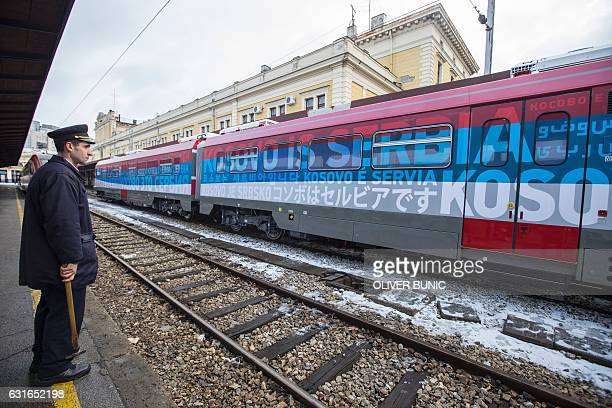A local station worker looks on at the main railway station in Belgrade on January 14 2017 A train from Russia decorated with the Serbian flag and...