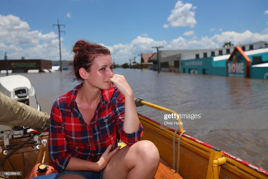 Local Storm Green looks on from a boat while shops are underwater as parts of southern Queensland experiences record flooding in the wake of Tropical Cyclone Oswald on January 29, 2013 in Bundaberg, Australia.Four deaths have been confirmed and thousands have been evacuated in Bundaberg as the city faces it's worst flood disaster in history. Rescue and evacuation missions continue today as emergency services prepare to move patients from Bundaberg Hospital to Brisbane amid fears the hospital could lose power.