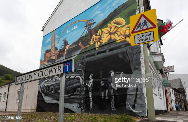 Local street artist Thomas Llewellyn has completed a mural depicting the history of the village in Miners Close on May 22 2020 in Trehadod Wales...