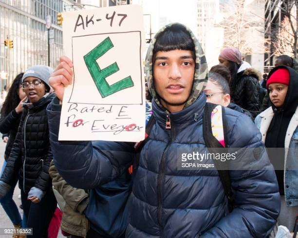 A local student seen with a placard during the National School Walkout a 17 minute walkout by students in honor of the 17 people who died one month...