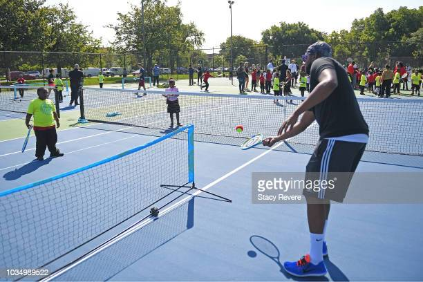 Local students participate in drills during the Laver Cup Legacy Court Ceremony at Garfield Park on September 17 2018 in Chicago Illinois